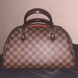 Gently used Louis Vuitton MM Ribera.